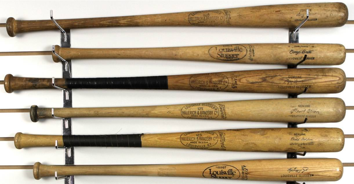 Store Model Signature Sluggers. Top to Bottom: Yogi (Larry) Berra, George Brett, Roger Maris, Hank (Henry) Aaron, Richie Ashburn, Ken Griffey, Jr.