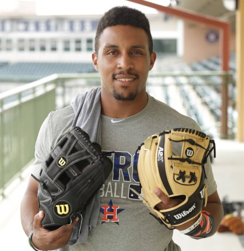 Tony Kemp Selecting a Wilson Glove 3