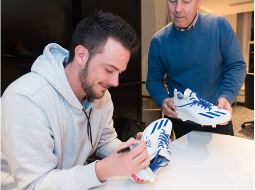 Kris Bryant signs his new deal with Adidas.