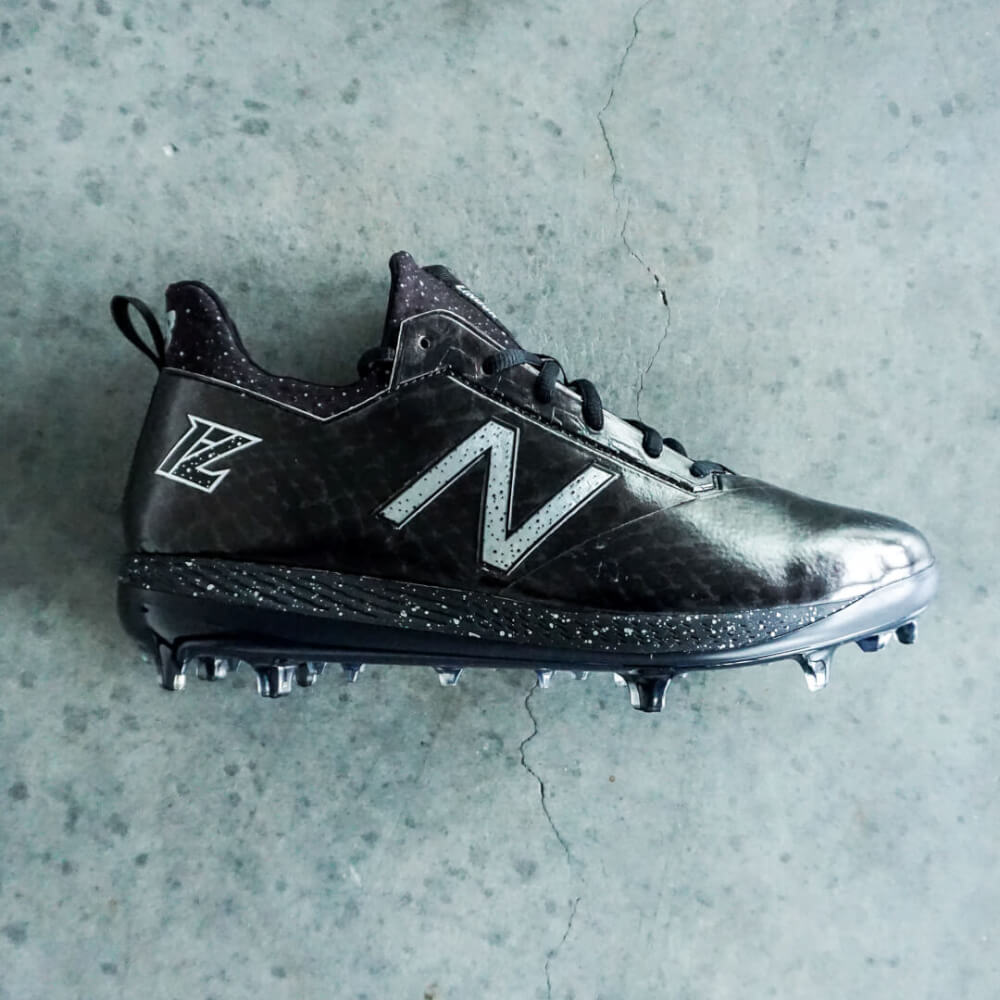 """1f4c96457 The COMPv1 cleats from New Balance offer glass fiber reinforced TPU  (molded) cleats that """"play like metal and feel like molded."""